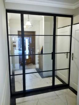 Drzwi nowoczesne do holu przeszklone loftowe ze szprosami